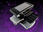 Stack Of Several Modern Mobile Phones On Purple Bright Fractal Background