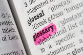image of glossary  - Glossary highlighted in dictionary with pen closeup - JPG