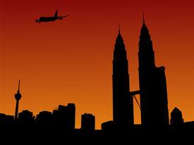image of petronas towers  - plane arriving in Kuala Lumpur at sunset illustration - JPG