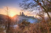 Winter sunrise over Corfe Castle with vibrant sky