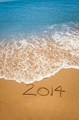 Year 2014 Written In Sand On Tropical Beach