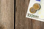 Euro currency over wooden background
