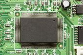 picture of transistor  - Green Electrical Circuit Board with microchips conductors and transistors - JPG