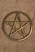 picture of pentacle  - close up of brass pentagram  - JPG
