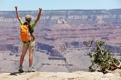 Grand Canyon hiking woman hiker happy and cheerful with arms raised up outstretched in joy. Winner a