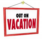 stock photo of sabbatical  - Out on Vacation words on hanging sign for store window or office wall to tell customers or co - JPG