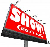 The words Show Don't Tell on a red billboard sign to tell writers to be illustrative, descriptive and exciting in sharing action in a story to move the plot along