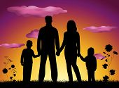 stock photo of family fun  - silhouette of Family on a sunset background - JPG