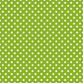 Vector seamless spring pattern with white polka dots on fresh grass green background