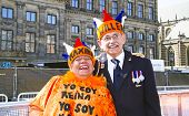 AMSTERDAM, NETHERLANDS - APRIL 30: Couple celebrating the coronation of the new king Willem Alexander from the Netherlands on the damsquare  on 30 april 2013