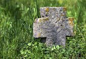 Exalted old stone cross