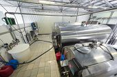 The workshop in the dairy farm with chrome tanks for milk