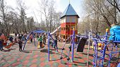 MOSCOW - MAY 1: Children with parents are playing on the playground in Sokolniki on May 1, 2013 in M