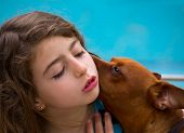 Brunette kid girl and dog pet mascot whispering ear