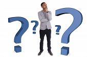 image of punctuation marks  - Young thoughtful african american man surrounded by question marks  - JPG