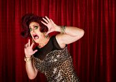 picture of drag-queen  - Frightened man in drag queen in theater - JPG