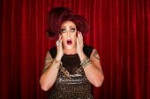 image of drag-queen  - Amazed drag queen with tattoos in theater - JPG