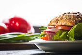 stock photo of tomato sandwich  - Fresh Homemade Sandwich with Ham Lettuce and Tomato - JPG
