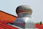 Stainless Steel Exhaust Fan On Roof With Blue Sky