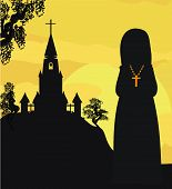 image of nun  - nun silhouette praying in front of the church  - JPG