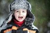 stock photo of cold-shoulder  - Three year old boy having fun in the outdoor Winter cold and snow - JPG
