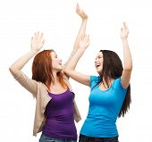 friendship, people and appiness concept - two happy dancing girls