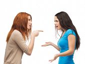 bullying, friendship and people concept - two teenagers having a fight