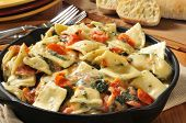 stock photo of lobster  - Lobster and ricotta ravioli in a cast iron skillet - JPG