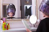 Girl Reading Magazine Drinking Coffee. Hairdryer In Hair Beauty Salon