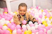 Happy Black Boy In Colored Ball On Birthday On Playground  The Concept Of Childhood And Holiday