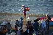 Crowd Of People Make Deal Fish At Seashore