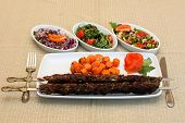 Grilled meat with carrots saute and salad