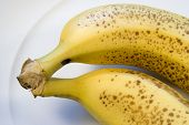 Two Ripe Bananas On White Plate