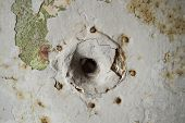 picture of peep hole  - close up of a peep hole in grunge metal the door of an old prison - JPG