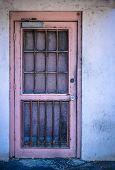picture of derelict  - Pink Door Of Derelict And Moldy House - JPG