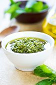 stock photo of pesto sauce  - Traditional Genovese pesto made of Basil Pine nuts and Parmesan cheese - JPG