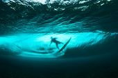 stock photo of watersports  - Underwater view of surfer and crystal clear wave - JPG