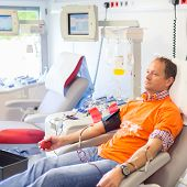 Blood donor at donation.