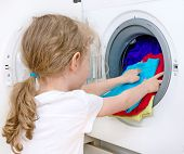Little Girl Doing Laundry. Housework Concept.
