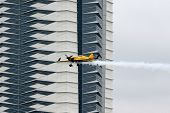 PUTRAJAYA, MALAYSIA - MAY 17, 2014: Nigel Lamb of Great Britain, in a MXS-R plane flies past the sky