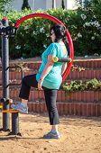 Woman Training On A Waist Back Massage Machine