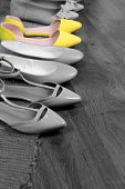 Concept of individuality.Bright color shoes among grey shoes