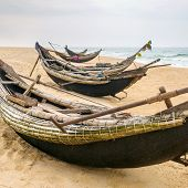 picture of coracle  - Old fisherman boats on the beach in Hue province - JPG