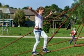 Teenage Girl Playing On Child Playground