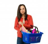 Beautiful cheerful brunette woman with basket full of cleansers