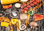 stock photo of braai  - Delicious grilled vegetable on burning coals - JPG