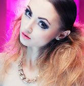 image of ombre  - Face close up of beautiful young woman with professional party make up false eyelashes - JPG