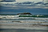 Spanish destination on Atlantic Ocean, Somo beach in Cantabria region, view on lighthouse poster