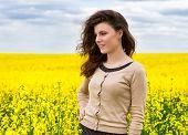 beautiful woman in yellow flower field