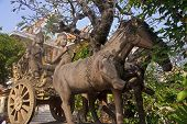 stock photo of charioteer  - Monument chariot before the temples of Wat Qnalom in Phnom Penh - JPG